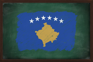 Kosovo flag painted with chalk on blackboard