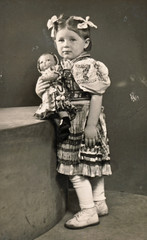 Little girl with dolly - circa 1955