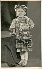 Little girl with doll - circa 1950
