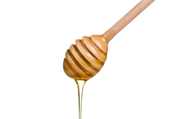 honey is dripping from the spoon