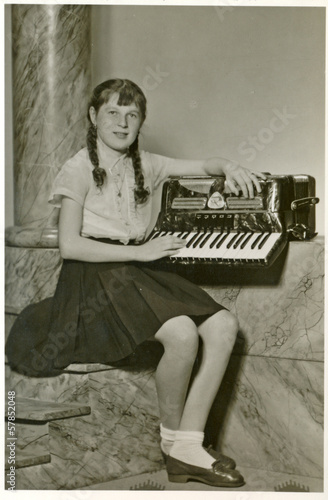 Girl with accordion - circa 1955