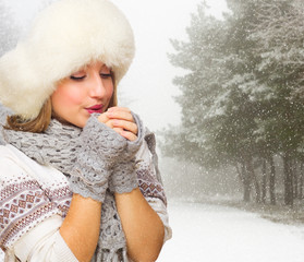 Young girl at snowy forest