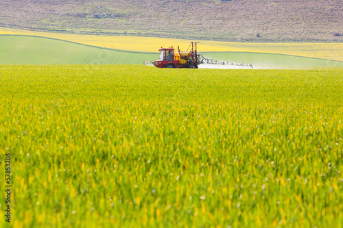 Crop sprayer in a field