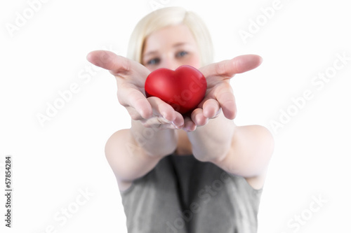 Woman presenting  red heart
