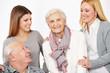 Leinwanddruck Bild Drei Generationen mit Senioren und Frauen
