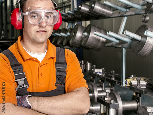 worker with antiphons and protection glasses