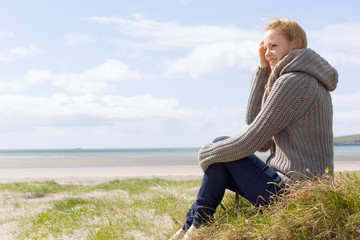 Attractive woman sitting on the beach