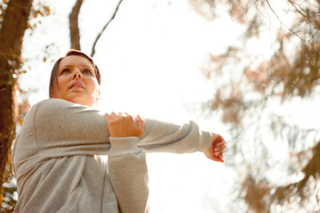 Woman stretching her arm and looking away