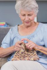 Mature woman knitting wool