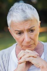 Pensive short haired elderly woman posing
