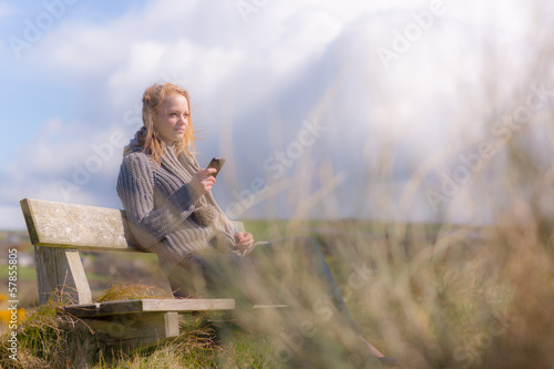 Attractive woman sitting on a bench