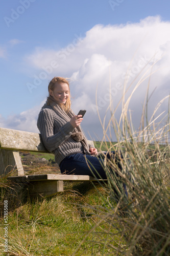 Beautiful woman sitting on bench on a sunny day