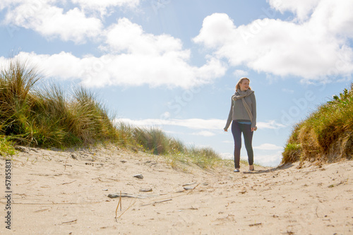 Blond woman standing on the beach