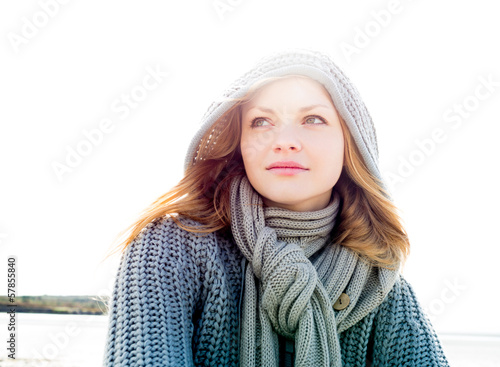 Young woman wearing a scarf