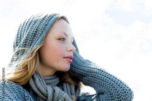 Pretty young woman wearing a scarf