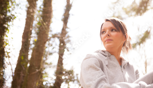 Sportswoman looking through the forest