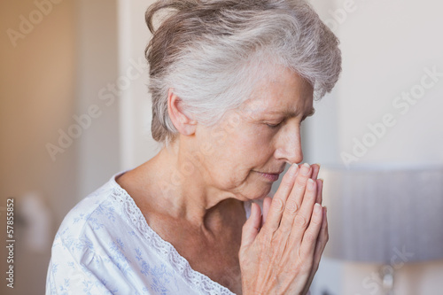 Retired woman praying