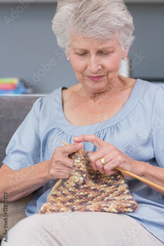 Mature woman knitting wool