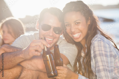 Happy young friends drinking together