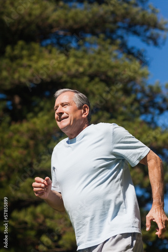 Cheerful retired man jogging