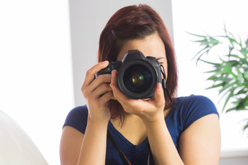Woman taking photo at the camera