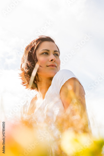 Peaceful woman reflecting in nature