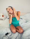 Gorgeous cheerful blonde listening to music