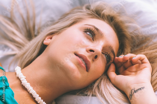 Gorgeous calm blonde lying on bed posing
