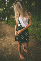 Gorgeous blonde standing on forest track