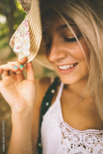Happy gorgeous blonde wearing straw hat