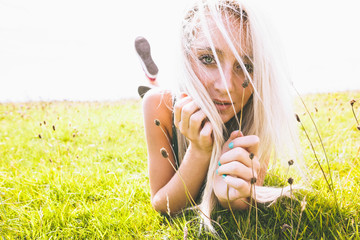 Content gorgeous blonde lying on lawn