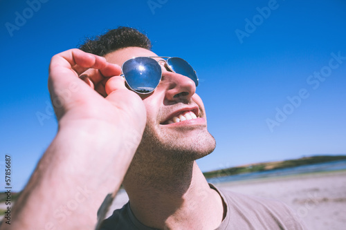 Attractive smiling man enjoying the sun