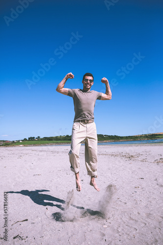 Attractive happy man jumping in the air