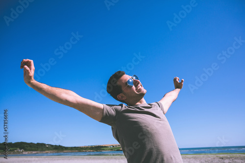 Attractive happy man enjoying the sun