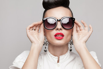 portrait of beautiful vintage styling model wearing sunglasses