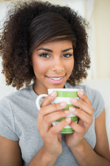 Pretty smiling brunette holding a mug