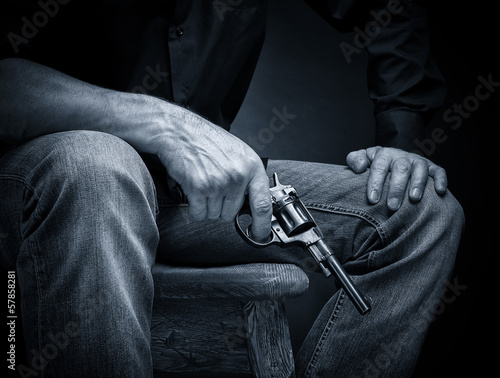 Male with a revolver in his hand