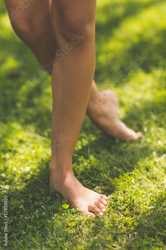 Picture of female bare legs standing on grass