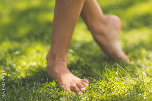 Picture of female bare feet standing on grass