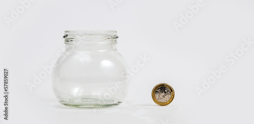 Euro coin by empty jar