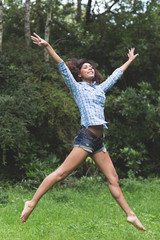 Gorgeous happy brunette jumping in the air