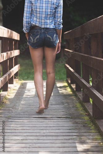 Backside of model walking on bridge