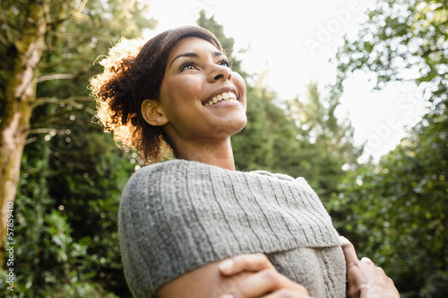 Low angle view of gorgeous laughing brunette