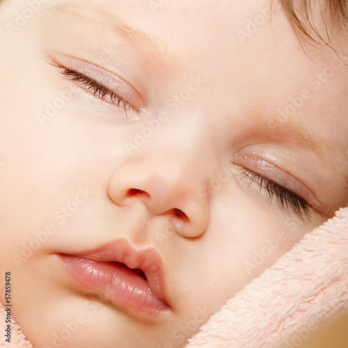 cute baby sleeping, beautiful kid's face closeup