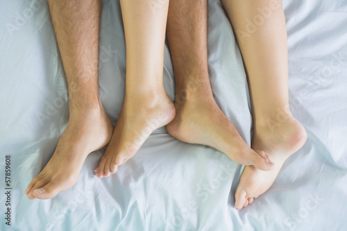 Peaceful couple cuddling in their bed