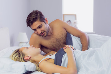 Handsome man leaning over his girlfriend