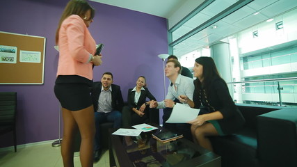 a group of young people is the female manager