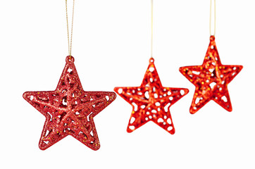 Christmas decoration. Red stars on white background. Selective f