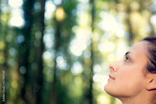 Young natural woman witting in a forest