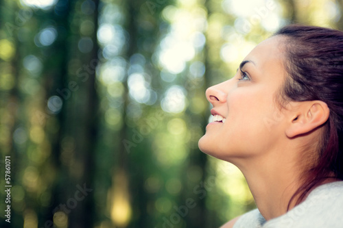 Gorgeous natural woman sitting in a forest